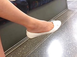 Candid milf dangling flats on train