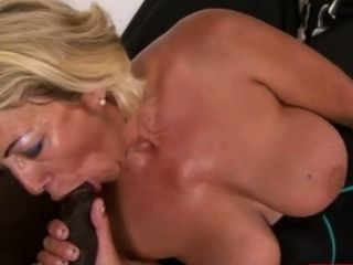 Horny GILF is deep throating a BBC in her living room.