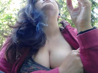 We smoke a cigarette together in a public garden while I show you my big boobs