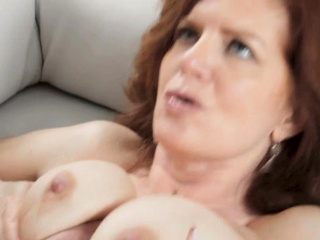 Busty MILF Andi James is ready to choke on some thick cock