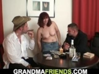 """Redhead granny in stockings double fucked on the table"""