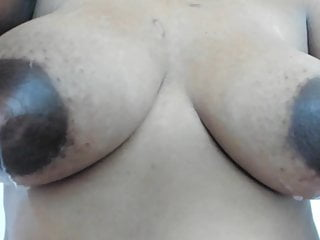 Dark milk tipped dripping black tits