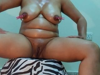 All lubed and naked webcam Desi whore pins her own boobies with pegs