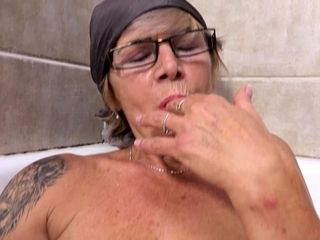 my busty grandma pissing in the bathtub