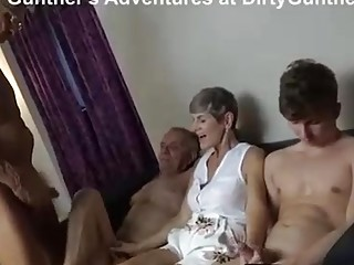 Short haired mature is having an orgy in her home and enjoying every single second of it
