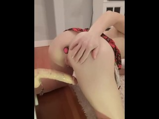 Squeezing in a huge dildo with my butt plug in my oiled ass