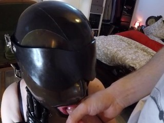 Miss Maskerade in latex & hooded drinking her Master's cum.