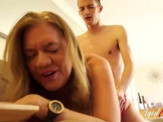 Mature blonde woman with saggy tits is sucking a fresh meat stick, before riding it like crazy