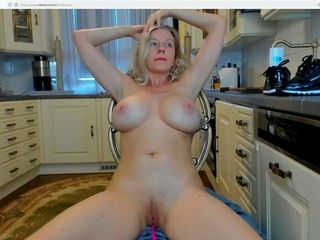 Naked in my kitchen playing with my pussy :)