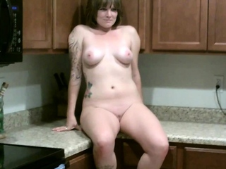 Misty takes naked photos in the kitchen