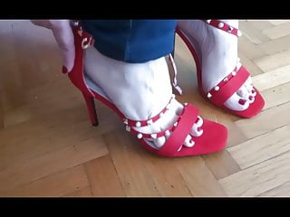 Feet with red shoes