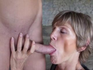 Scanty dude strapped and used by vicious older woman outdoors