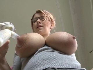 Fresh breast milk being pumped and squeezed