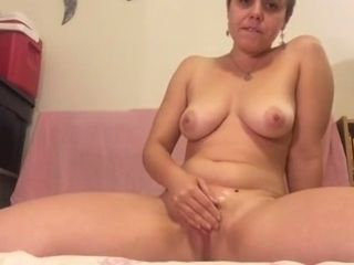 This short haired skank loves her Hitachi wand and she's got suckable tits