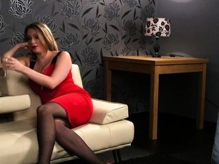 Glam clothed busty milf spreads legs