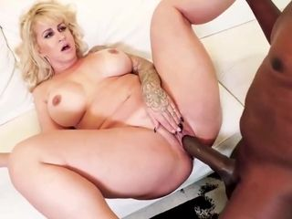 Big ass blonde woman with tattoos, Ryan Conner is spreading up wide for a horny, black guy