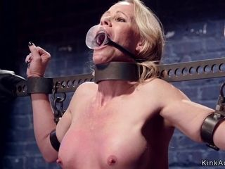 Housewife ball-gagged in iron stock lashed