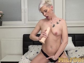 Mature woman with short hair Kathy White uses dildo solo