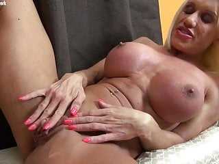 Naked female bodybuilder porn star strokes her huge clit
