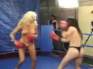 Topless female boxing as blonde battles brunette with body