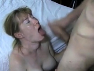 Mature with gigantic mounds tugs his stiff penis