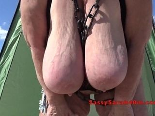 Massive hanging tits wrapped in chains