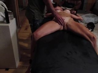 'super hot body Lucy tied down on the massage table'