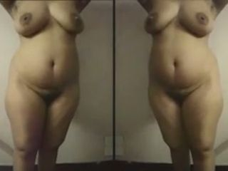 Horny Indian woman with the hottest belly around is showing off her curves