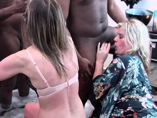 MILFs suck monster dicks in Jacuzzi at a swingers party