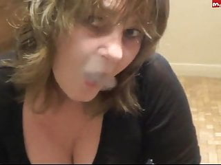 Clothed Milf Smokes and talks dirty