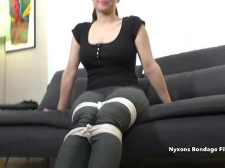 Stud binds up a clad dark haired mature woman on camera
